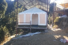 swiss-cottage-tents-pitched-under-corrugated-sheet-